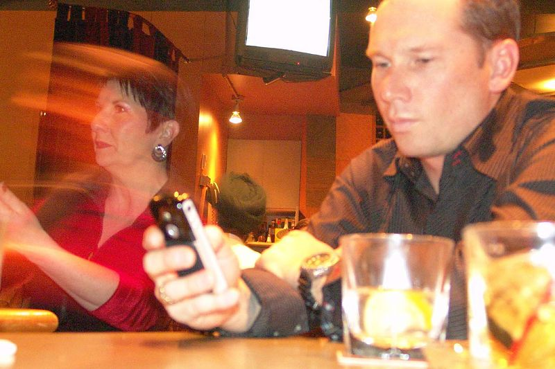 At the bar afterwords. Cool motion blur of my Mom.