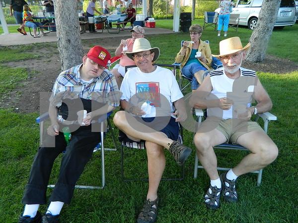 John Garton, Ted Hugghins, and Kent Isvik enjoying the show.