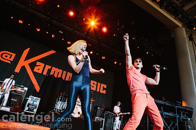 "Amy Heidemann and Nicholas Louis ""Nick"" Noonan of Karmin performs live on stage at the Klipsch Music Center in Indianapolis on July 12, 2013 opening for the Jonas Brothers"