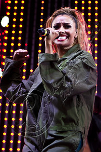 UNIVERSAL CITY, CA - JUNE 08:  Singer / actress Kat Graham performs at the 5 towers summer music spotlight series at 5 Towers Outdoor Concert Arena on June 8, 2012 in Universal City, California.  (Photo by Chelsea Lauren/WireImage)
