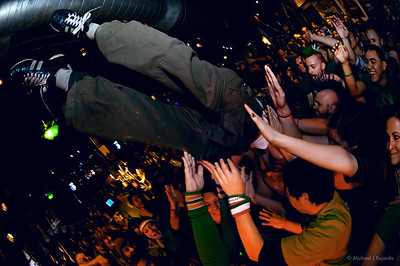 Winner of the green beer drinking contest crowd surfs at the Darling Thieves Show 93.3 KTCL 2011 Keggs and Eggs St. Patrick's Day Lodo's Bar and Grill Denver, CO  March 17, 2011