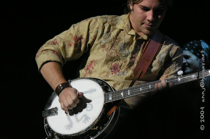 Chad Jeffers playing the guitar monkey banjo.