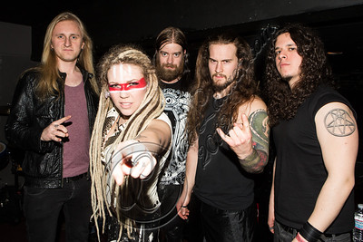 WEST HOLLYWOOD, CA - DECEMBER 20:  (L-R) Musicians Jasio Kulakowski, Kobra Paige, Peter Dimov, Griffin Kissack and Charlie Parra del Riego of the band Kobra & the Lotus pose backstage at The Whiskey a Go Go on December 20, 2012 in West Hollywood, California.  (Photo by Chelsea Lauren/WireImage)