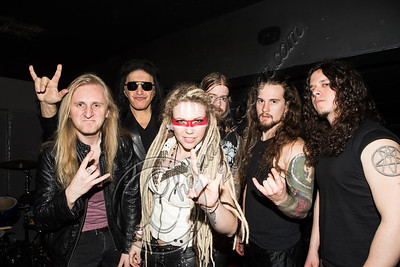 WEST HOLLYWOOD, CA - DECEMBER 20:  (L-R) Musician Jasio Kulakowski of the band Kobra and the Lotus, recording artist Gene Simmons and musicians Kobra Paige, Peter Dimov, Griffin Kissack and Charlie Parra del Riego of the band Kobra & the Lotus pose backstage at The Whiskey a Go Go on December 20, 2012 in West Hollywood, California.  (Photo by Chelsea Lauren/WireImage)