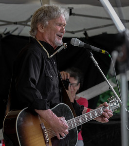 Kris Kristofferson on the Rainbow Stage at the 2013 Clearwater Festival with photographer Maxine Smith (one half of Econosmith).