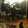 rehearsal at Chris' house.  Cat Norbu is eyeing things. At another rehearsal the cat ran straight up the open piano lid, slid down to a woodrack on the floor underneath, got entangled in that, shot up like a spring and dashed out of the room, not to be seen again for the rest of the evening