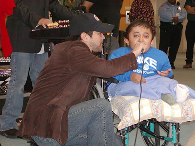 La Mafia entertaining the children at Shriner's Hospital