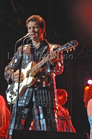 """Singer Chris Isaak performs live in concert at Lake Las Vegas Resort 2007, joined on stage by audience members dancing to his cover of the Jerry Lee Lewis song, """"Bonnie B."""""""