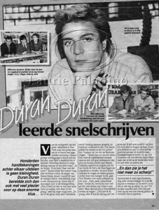 Duran Duran photos of autograph signing of music video in Dutch magazine. Pictured are Andy Taylor, Roger Taylor, John Taylor, Simon Le Bon and Nick Rhodes