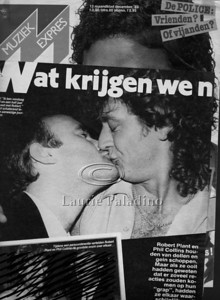 Drummer Phil Collins and singer Robert Plant share a kiss for the cameras at a party in New York City following their concert.