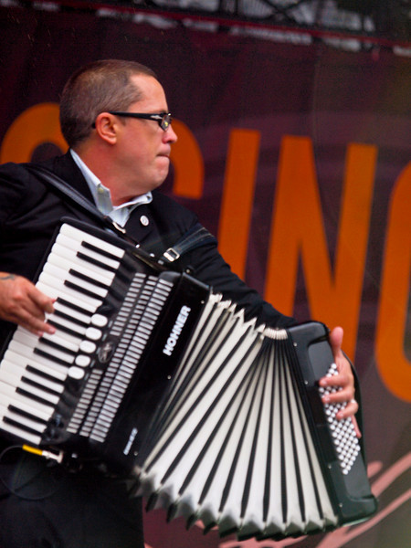"""FLOGGING MOLLY <br /> AMD (West) Stage<br /> Saturday, October 03, 2009, 4:00 - 5:00 PM<br /> Accordion player Matthew Hensley.<br /> <br />  <a href=""""http://www.floggingmolly.com/"""">http://www.floggingmolly.com/</a>"""