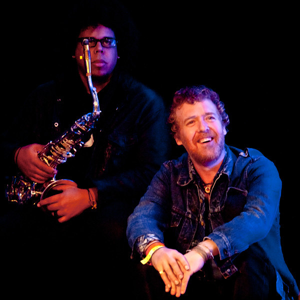 Glen Hansard and Jake Clemons enjoy a performance by Sarah Siskind<br /> Saturday morning (way too early), March 17, 2012<br /> Four Seasons Hotel, Austin, Texas<br /> Captured live at the KUT SXSW Showcase<br /> Image of Glen captured by Sean Murphy ©2012.<br /> Please do not reproduce without permission from the artist.