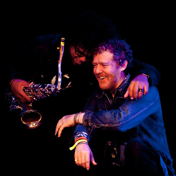 Glen Hansard and Jake Clemons share a moment<br /> Saturday morning (way too early), March 17, 2012<br /> Four Seasons Hotel, Austin, Texas<br /> Captured live at the KUT SXSW Showcase<br /> Image of Glen captured by Sean Murphy ©2012.<br /> Please do not reproduce without permission from the artist.