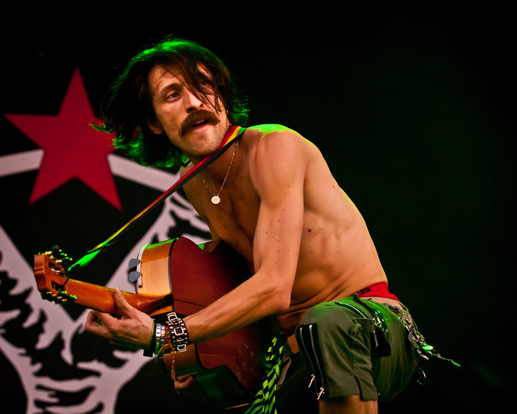 Eugene Hütz<br /> Vocals/Acoustic Guitar/Percussion/Fire Bucket <br /> Gogol Bordello<br /> AMD Stage, 6:30-7:30 pm<br /> Austin City Limits Festival<br /> Saturday, October 9, 2010<br /> Photo by Sean Murphy © 2010.<br /> Please do not reproduce without permission.