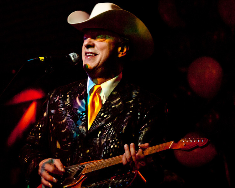 Junior Brown<br /> Master and inventor of the guit-steel<br /> Onstage at the KOOP Radio fundraiser<br /> Held at historic Antone's, 5th Street, Austin, Texas<br /> Saturday, February 5, 2012<br /> Photo by Sean Murphy © 2012.<br /> Please  do not reproduce without permission.