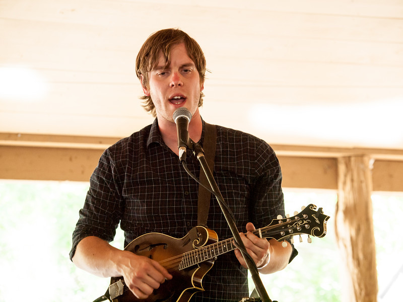 MilkDrive<br /> Noah Jeffries – Guitar, harmony vocals<br /> Campground Stage<br /> Camp Ben McCullough<br /> Old Settler's Music Festival<br /> Sunday, April 21, 2013<br /> Please do not reproduce without permission.<br /> Photos © Sean Murphy 2013.