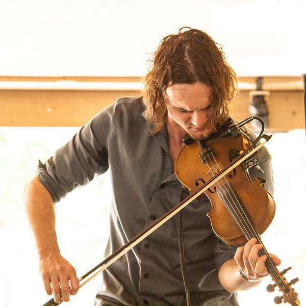 MilkDrive<br /> Brian Beken – Fiddle, lead vocals<br /> Campground Stage<br /> Camp Ben McCullough<br /> Old Settler's Music Festival<br /> Sunday, April 21, 2013<br /> Please do not reproduce without permission.<br /> Photos © Sean Murphy 2013.