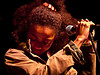 Nneka<br /> Onstage at KUT's Day Stage Cafe<br /> SXSW<br /> 17 March 2010<br /> Photos by Sean Murphy © 2010.<br /> Please do not reproduce without permission.
