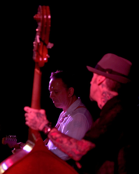 Ronnie James Weber looks to Jimmie Vaughan <br /> along with Omar Kent Dykes On The Jimmy Reed Highway<br /> Blues on the Green, Austin, Texas<br /> 8 August 2007<br /> Photo © Sean Murphy 2007, please do not reproduce without permission.