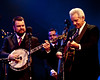 Rob McCoury (banjo), Alan Bartram (bass) and Del McCoury (guitar) of the Del McCoury Band solo during their appearance with the Preservation Hall Jazz Band at SXSW 2011.  March 17, 2011.  Photo © Sean Murphy, 2011.