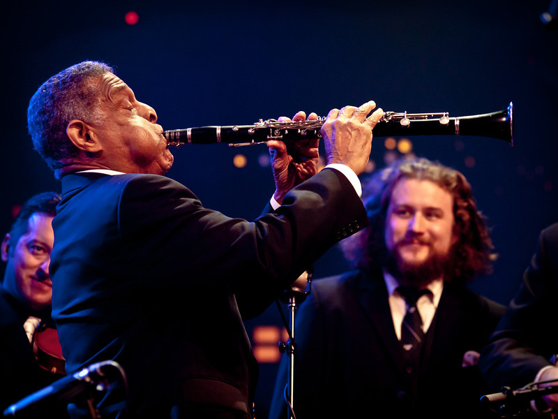 Jim James (My Morning Jacket, Monsters of Folk), looks on with appreciation as Charlie Gabriel, from Preservaton Hall Jazz Band wails at the Austin City Limits taping at Moody Theatre during SXSW 2011.  © Sean Murphy, 2011.