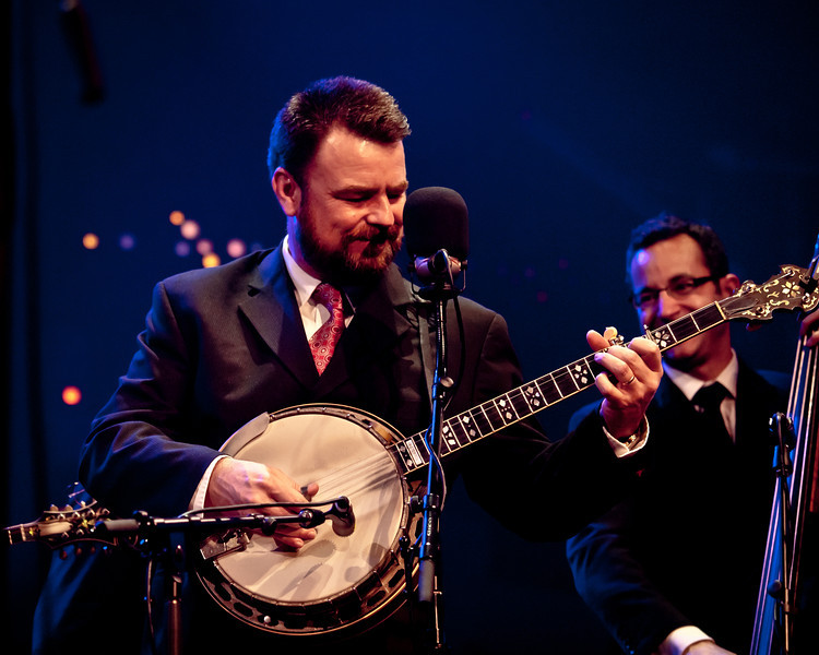 Rob McCoury (banjo) soloing on the new Austin City Limits stage with the Del McCoury Band alongside Alan Bartram (bass).  Captured in Austin, Texas during a joint taping with Preservation Hall Jazz Band during SXSW 2011 on March 17, 2011.<br /> Photo © Sean Murphy, 2011.