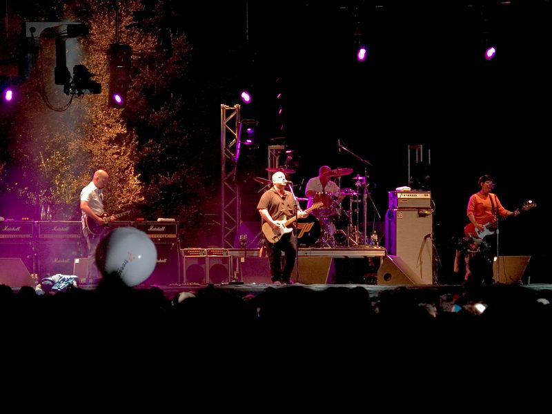 The Pixies onstage at the Austin City Limits Festival, Austin, Texas 18 September 2004.  Joey Santiago on guitar, Charles Thompson, aka Frank Black (Black Francis) vocals and guitar, Dave Lovering on drums, and Kim Deal (bass).