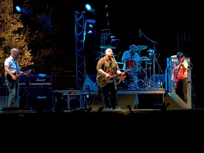 The Pixies at the Austin City Limits Festival, Saturday, 18 September 2004.  Joey Santiago on guitar, Charles Thompson, aka Frank Black (Black Francis) vocals and guitar, Dave Lovering on drums, and Kim Deal (bass).