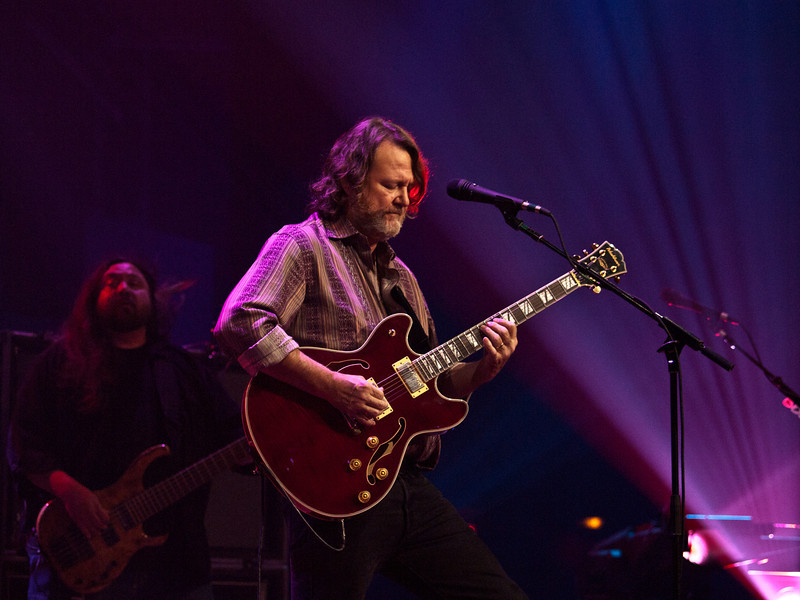 John Bell is the lead singer and rhythm guitarist for the American rock band Widespread Panic, where he is known for his raspy southern drawl that hits a variety of octaves. He is frequently called JB by fans. For more than 25 years, the voice has fueled 150 concerts a year all over the country and created a road warrior mentality for the band and its fans. Captured at Moody Theatre on March 17, 2011 by Sean Murphy ©2011.  Please do not reproduce without permission of the photographer.