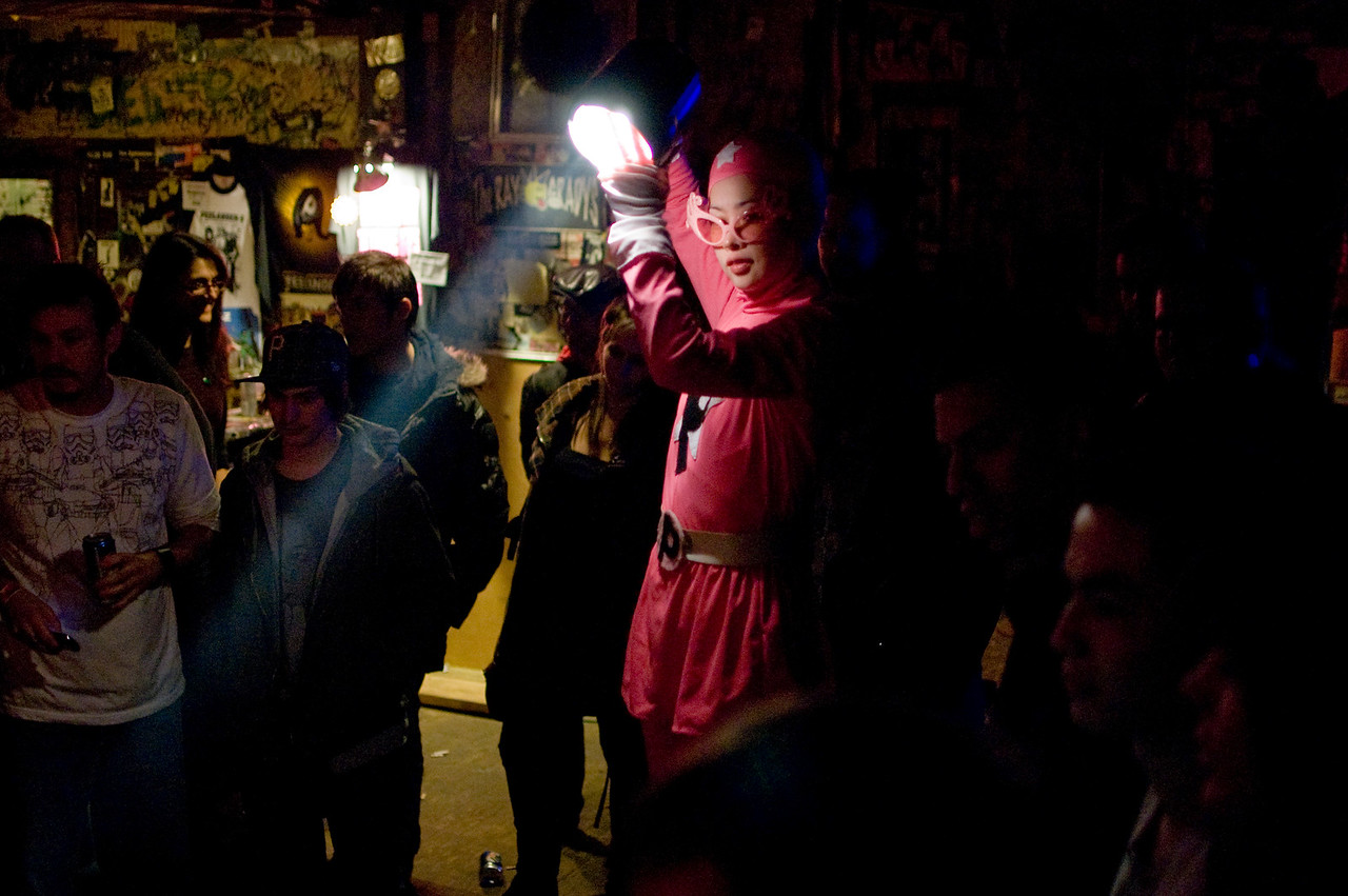 PEELANDER-PINK lighting the band as they play in the floor of the club