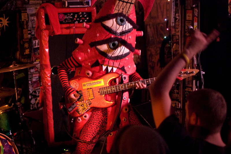 PEELANDER-RED as the bass guitar squid monster.