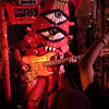 PEELANDER-RED as the bass guitar squid monster.