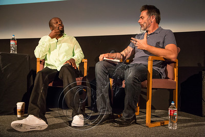 SANTA MONICA, CA - SEPTEMBER 23:  Rapper / poitician Wyclef Jean (L) and journalist Geoff Boucher speak at live talks Los Angeles: an evening with Wyclef Jean Aero Theatre on September 23, 2012 in Santa Monica, California.  (Photo by Chelsea Lauren/WireImage)