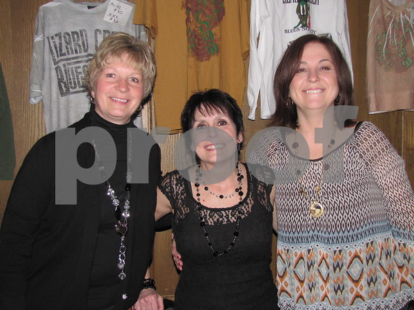 Karen Wood, Sara O'Leary, and Carolyn Millea worked selling merchandise for the Lizard Creek Blues event.