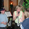 Peggy Coyle giving kazoo lessons to kids at St. Patty's Day, Papa Joe's.