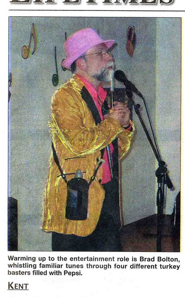 Whatever credibility I had in Kent has disappeared since this photo appeared in the local Kent paper.  I was hired to play baster for a Mardi Gras party at a local church, and decided to appear in really wacky attire, thinking that no one I know would see me.  Then the photographer showed up . . .