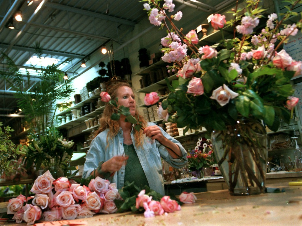. Blossoms Head Floral Designer Laural Wayna, who has been creating unique arrangements for over 20 yrs,  uses 5 dozen pink roses from Ecuador and massive cherry blossom branches to create an display for Motown singer Aretha Franklin in the Birmingham shop\'s workroom behind its retail space. Between Easter, Passover, Spring and upcoming Mother\'s Day orders, the design staff at the elegant floral shop is literally up to its neck in flowers.