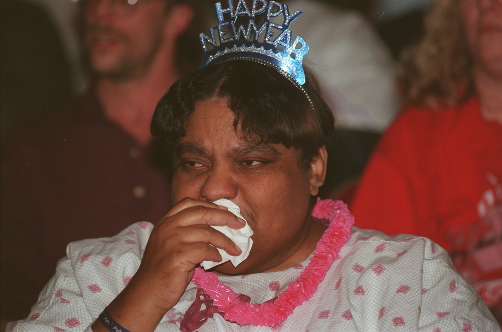 """. Henry Ford Hospital patient Sue Scott, of Inkster, tears up as  Aretha Franklin sings a gospel song during the Motown legend\'s concert for patients at the Hospital yesterday afternoon. The half-hour show, that had the feel of a church revival, consisted mostly of gospel numbers. Looking around at the room full of people, many of whow were in wheelchairs , with Ivs in town, Franklin said, \""""For the next twenty minutes or so, No body in here is going to be sick.\"""""""
