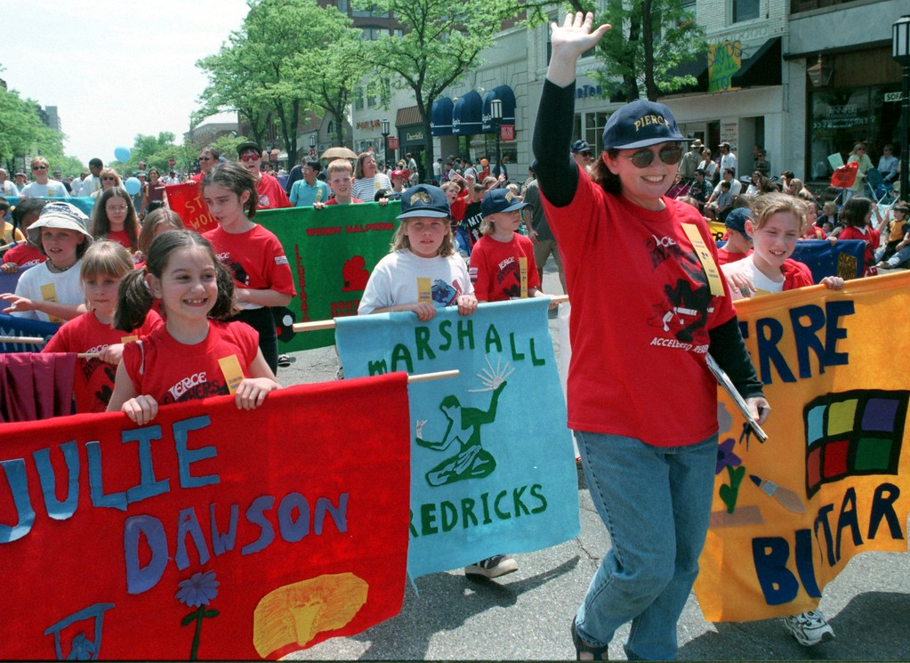 . A contingent of fourth graders from Pierce Elementary carried homemade banners depicting the contributions of famous Michiganians, like sculptor Marshall Fredricks and Motown legend Aretha Franklin, as they made their way down Woodward to maple during the Celebration Birmingham Parade yesterday afternoon..