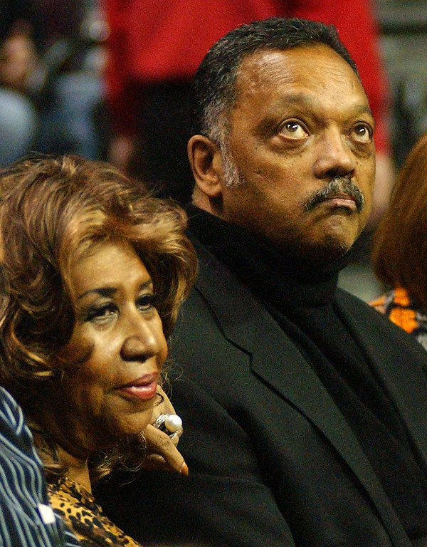 . Aretha Franklin and Jesse Jackson enjoy the game between the Detroit Pistons and the Miami Heat.  Photo taken on Friday, February 11, 2011, at The Palace in Auburn Hills, Mich.  (The Oakland Press/Jose Juarez)