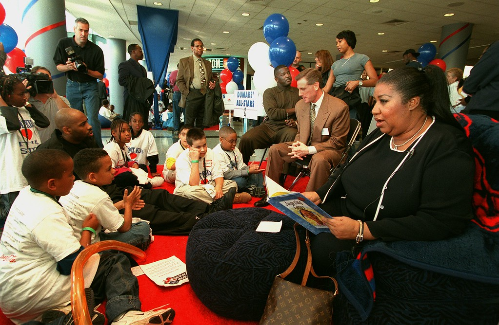 """. Aretha Franklin, right,  reads the book \""""Amazing Grace\"""" to elementary school kids at the Palace of Auburn Hills.  The Pistons and it players, along with politicians, entertainers, TV, radio and newspaper personalities were among the reading \""""All Stars\"""" launching the community literacy project."""