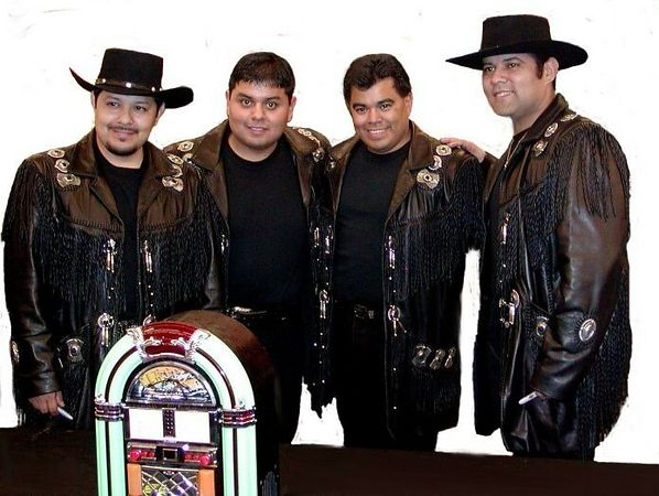 "Los Palominos were in town promoting their new CD , ""Canciones De La Rockola"" (songs from the jukebox).  This CD is a tribute to the artists who influenced them  (the little jukebox in front was a prize given away to a fan in a drawing, it's actually a CD player."