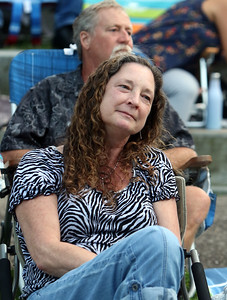 The Eagles Hotel California, a tribute band, plays at Boarding House Park in the first concert of the 2021 Lowell Summer Music Series. Jill Kohlenberger of Lowell. enjoys the music.  SUN/Julia Malakie