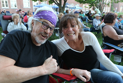 The Eagles Hotel California, a tribute band, plays at Boarding House Park in the first concert of the 2021 Lowell Summer Music Series. Arthur and wife Lisa Malcuit of Dracut. SUN/Julia Malakie
