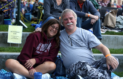 The Eagles Hotel California, a tribute band, plays at Boarding House Park in the first concert of the 2021 Lowell Summer Music Series. Tammy and husband Jimmy Demers of Lowell. SUN/Julia Malakie
