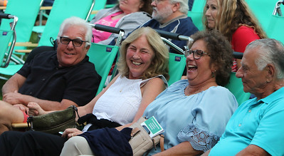 The Eagles Hotel California, a tribute band, plays at Boarding House Park in the first concert of the 2021 Lowell Summer Music Series. From left, Mark and wife Nanci Meehan, and Cindy and husband Don Polsi, all of Lowell. SUN/Julia Malakie