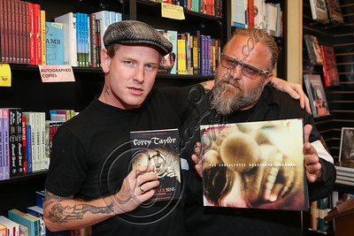 "WEST HOLLYWOOD, CA - JUNE 29:  Musicians Corey Taylor (L) and M. Shawn Crahan aka ""Clown"" of Slipknot attend the book signing of M. Shawn Crahan's book ""Apocalyptic Nightmare Journey"" at Book Soup on June 29, 2012 in West Hollywood, California.  (Photo by Chelsea Lauren/WireImage)"