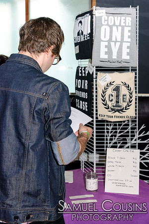 Cover One Eye's merch table.