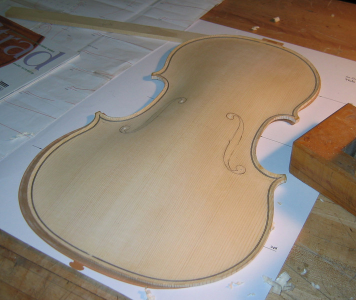 These pictures, taken July 5, show work progressing on shaping the interior of the top and back of the viola.<br /> <br /> The f-holes are also traced onto the top of the instrument.