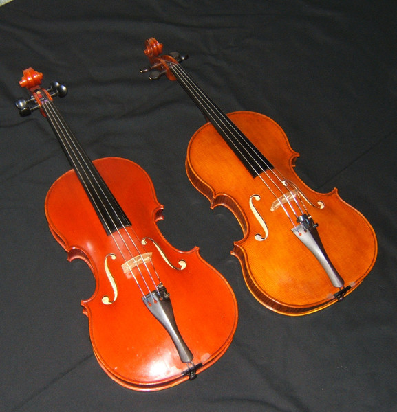 This shows the new Harrison viola (right) next to the viola by Thomas Oliver Croen (Gold Medal winner -VSA 1984) which I played from June 1985 until the completion of the new instrument. <br /> <br /> The Croen is now in the possession of the University of Ottawa's Department of Music. <br /> <br /> The Harrison is about the same width but is nearly 3/4 inch shorter, making it easier to play.